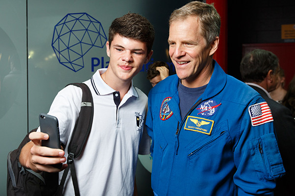 A student taking a selfie with former NASA Astronaut