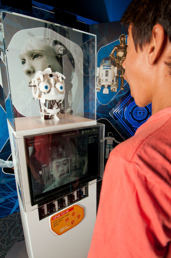 A robot face mimicking a young boys facial expression in the Science Fiction Science Future Exhibition.