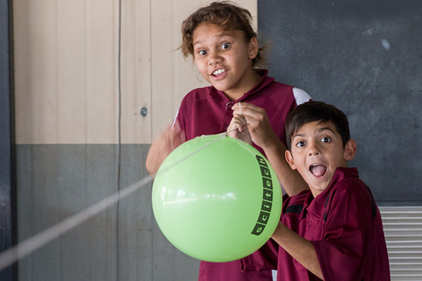 Two students from the Aboriginal Education Program holding a Scitech branded balloon