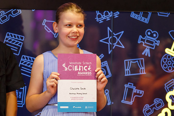 Young female teenage accepting a Woodside sponsored Scitech Science award.