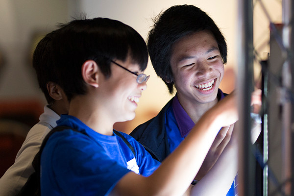Two students from the Scitech gifted and talented program laughing together