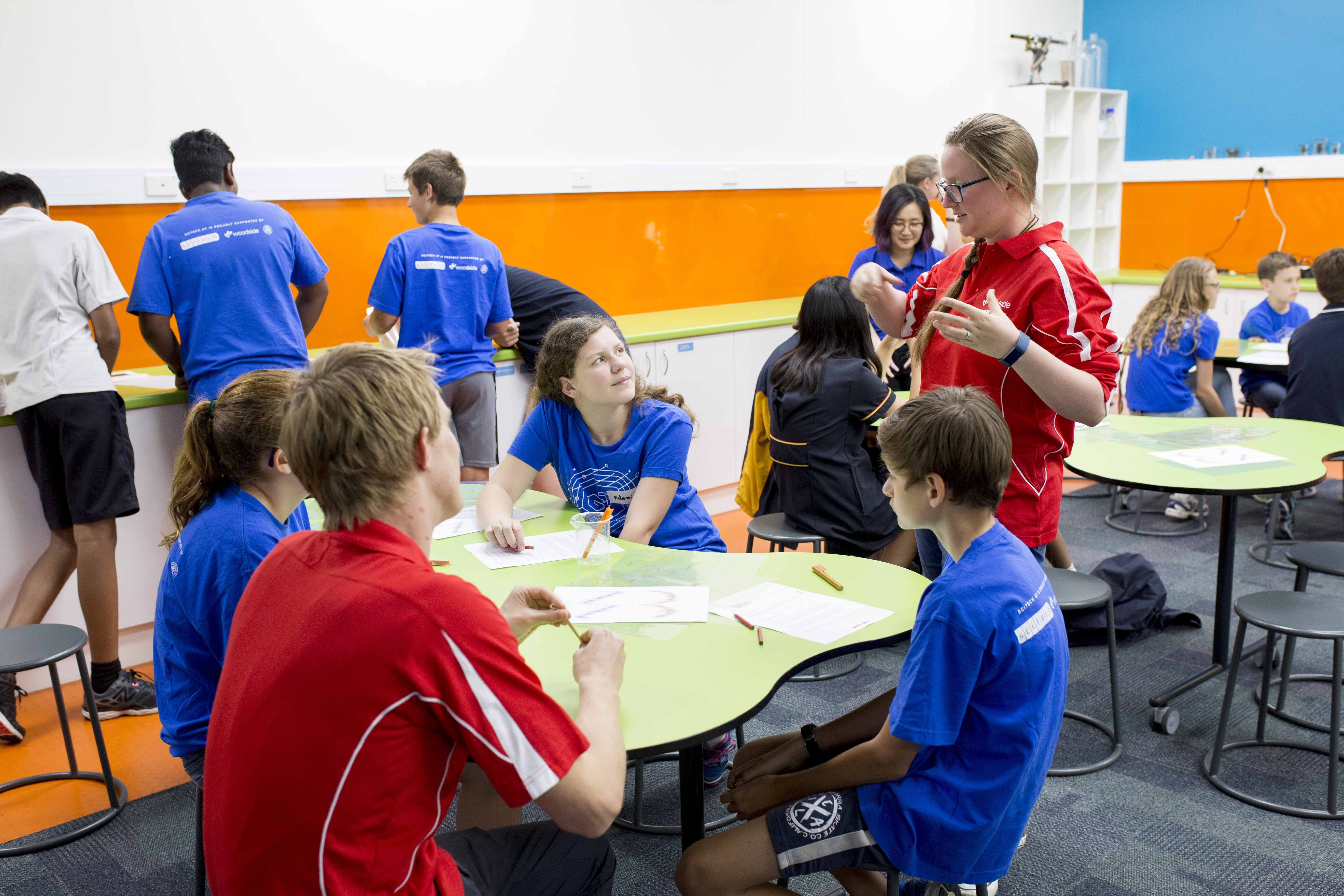 A group shot of students in the Scitech gifted and talented program discussing ideas