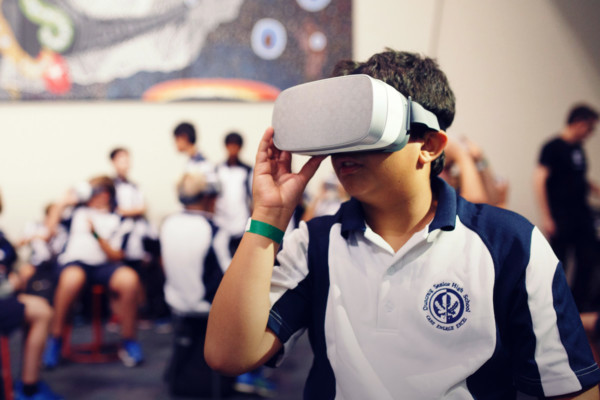 A student wearing a VR headset.