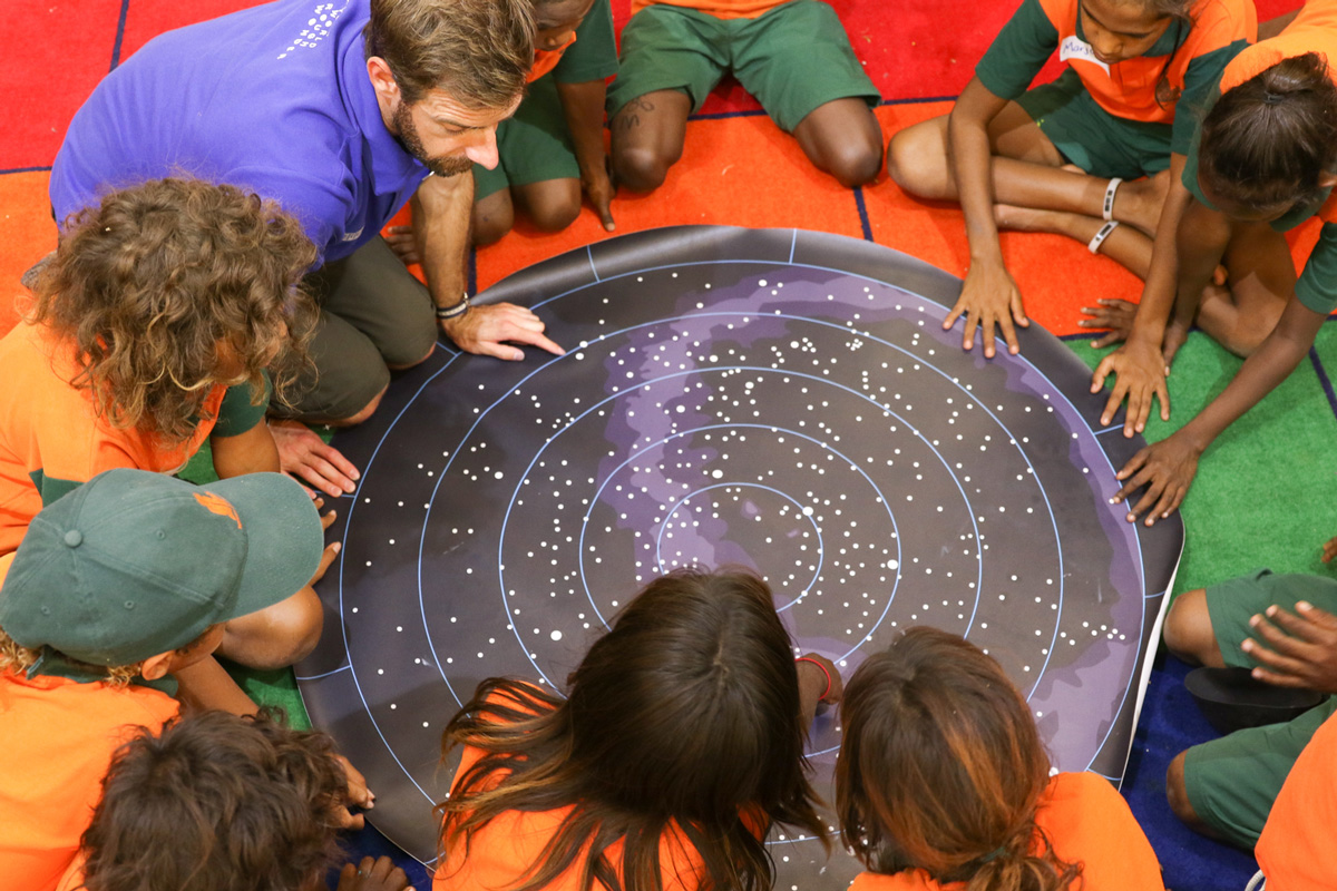 Aboriginal Education Program students look at a star map.