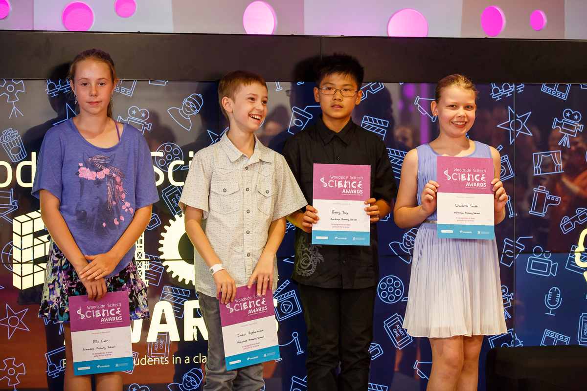 A group of students holding up their science awards.