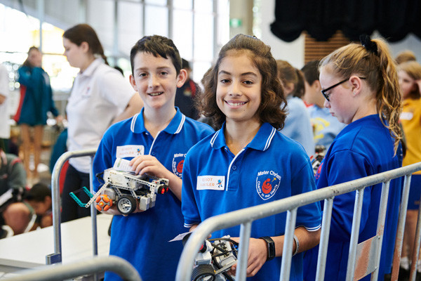 Group of students holding RoboCup prototypes