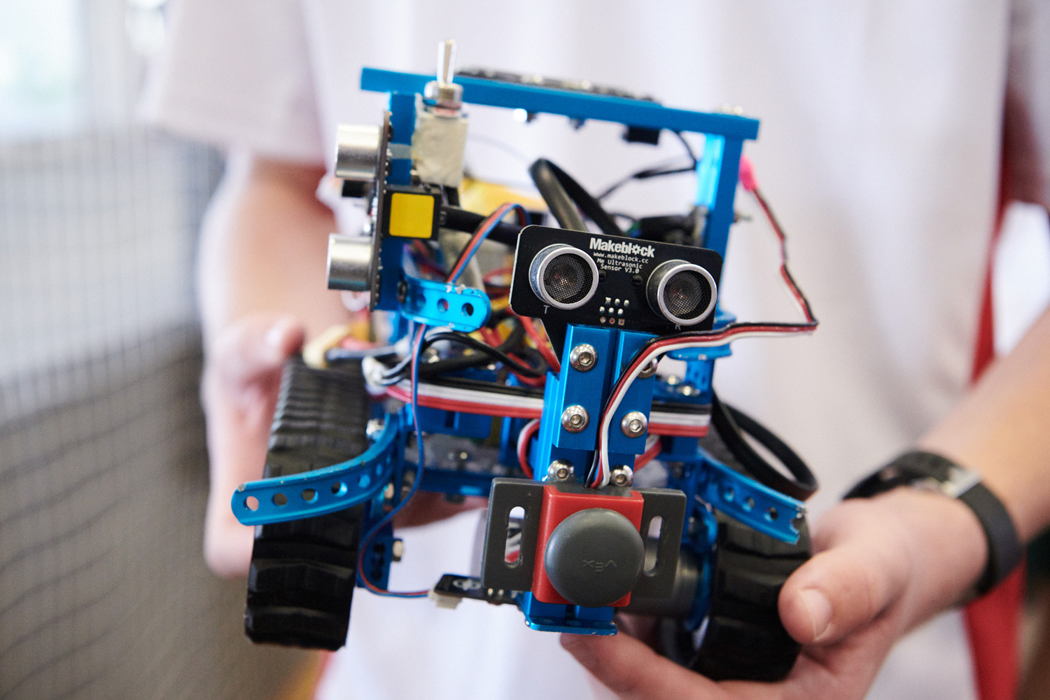 Student holds a RoboCup prototype.