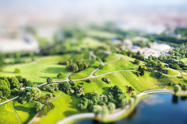 Tilt shift landscape of trees and a modern built environment
