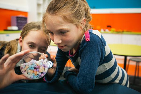 kids exploring colour in a lab workshop