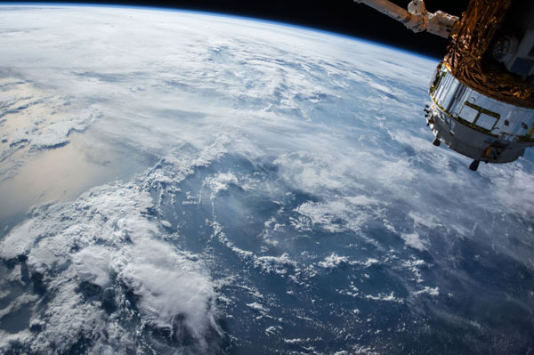 View of the earth from space with cloud cover