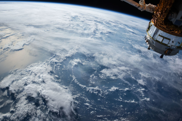 a view of the earth from space, the earth is cloudy.