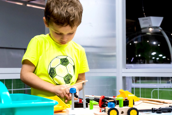 Boy experimenting with tools and toys in the RTIC Tinkering Space