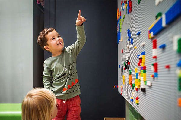 Boy playing with lego in Tinkering Space