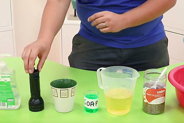 Presenter with ingredients on how to make effective soap at home.