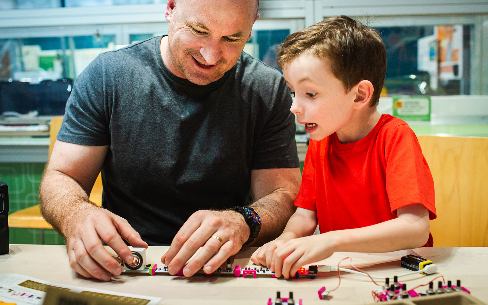 Father and son tinkering at home with electrical circuits