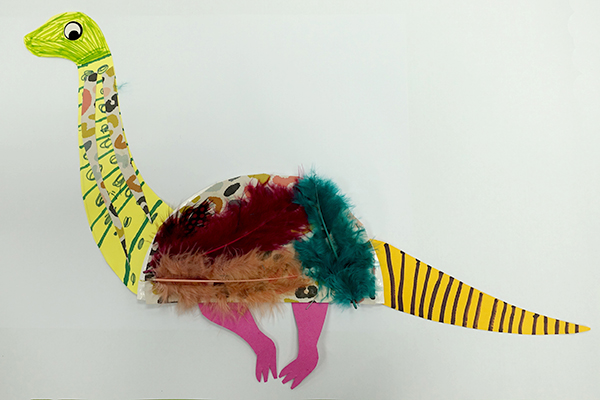 A craft dinosaur made of feathers and paper.