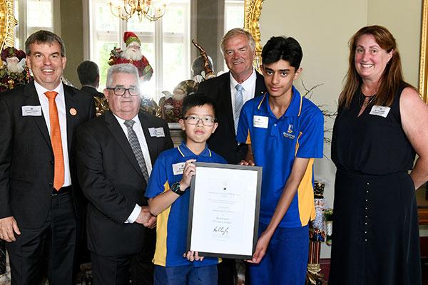 Two children receiving award.