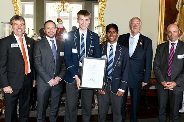 Two teenage boys receiving an award.