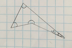 A drawing of a triangular shape with angles drawn in the corners on lined paper.