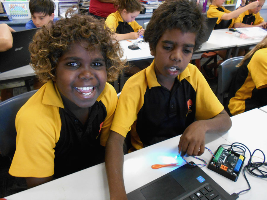 Indigenous students enjoy learning about electrical circuits in a classroom.