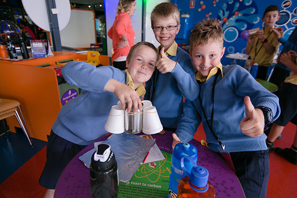 A team of three primary school students showing off their Challenge Day brainstorm activity