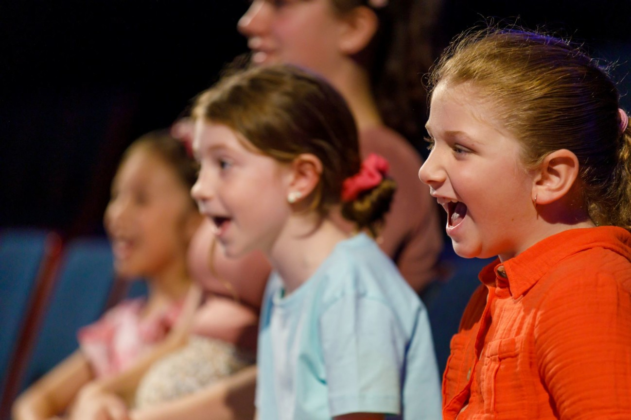 Excited children at Scitech birthday party science theatre show
